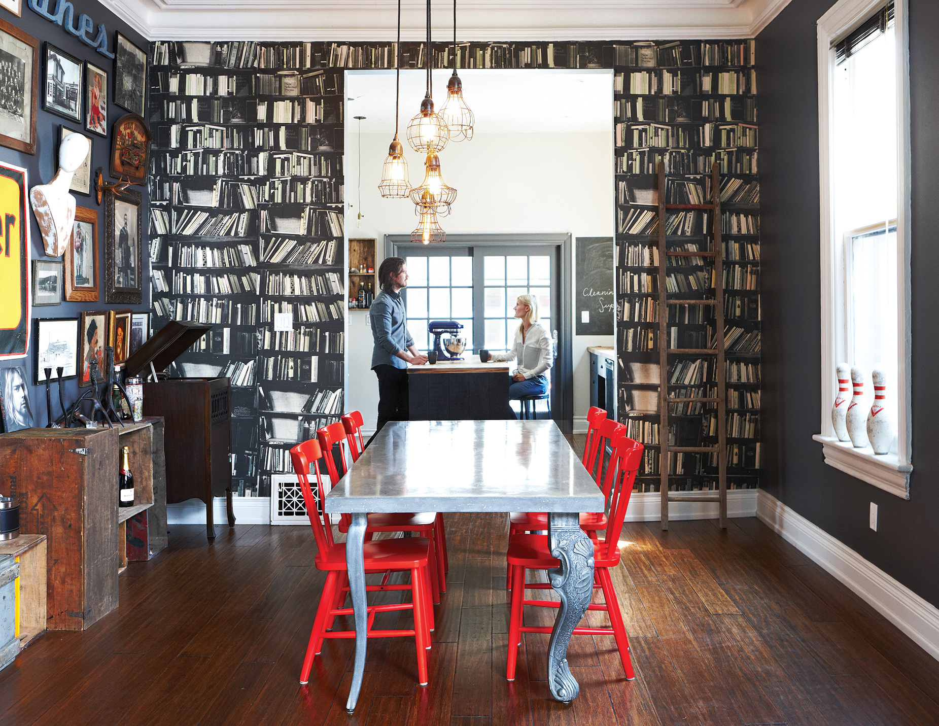 A one-dimensional library delivers the English-manor look without the fuss and dust. Wallpaper by Deborah Bowness; table legs by Castor; custom tabletop  by Concrete Elegance; IKEA chairs; lights from Phil'z.