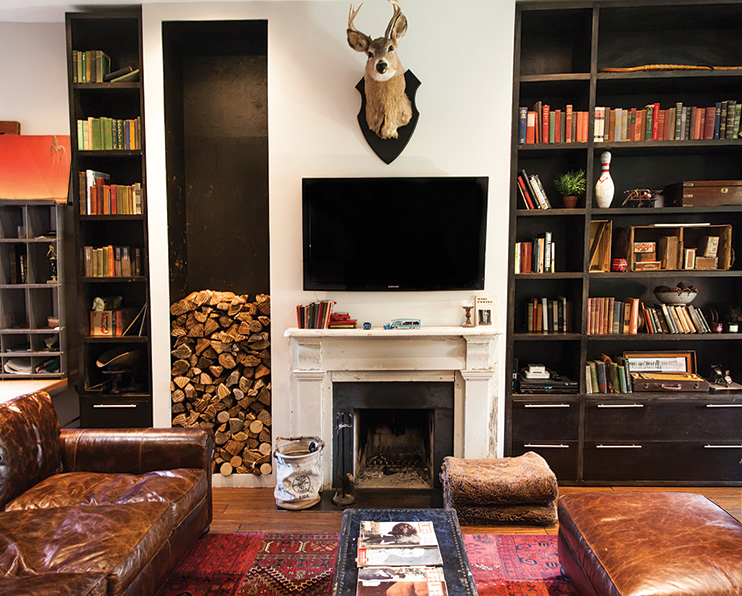 Milne housed Morgan's heirlooms and antiques in maple shelving units, which run 3.25 metres up and five metres across the living room. Leather sofa from Restoration Hardware.