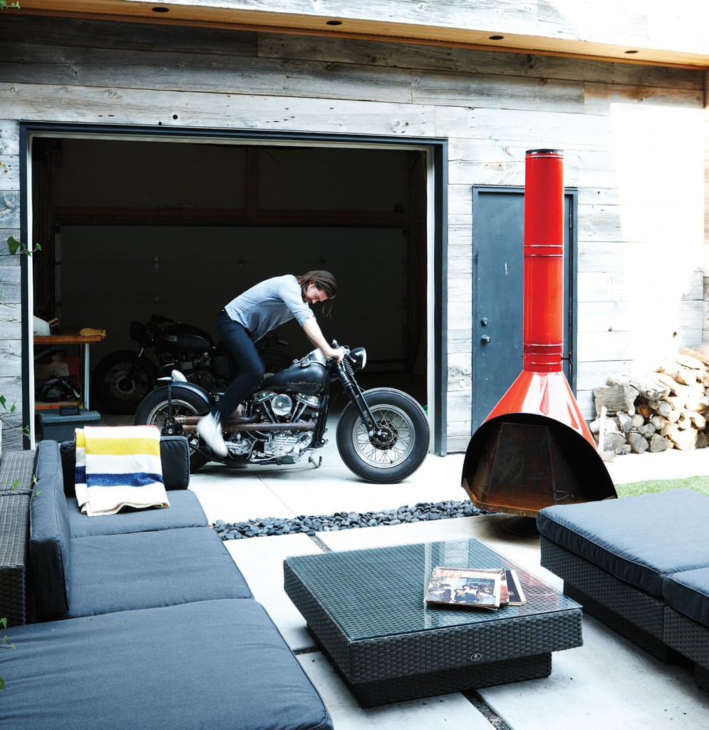 The back patio is furnished with Kijiji finds and the garage is clad in the same reclaimed wood – from Canadian Salvaged Timber – as the bedroom's feature wall.