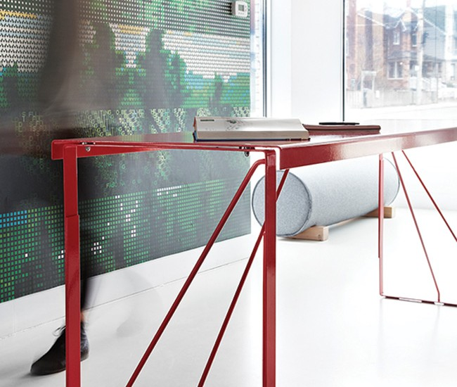 "Common Good (Commercial Studio): Upholstered ""log"" seats (made by DesignRepublic) and a red, bar-height ""kitchen table"" (made by Kenadian) furnish the pristine space."