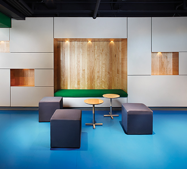 Spin Toronto (Ping-Pong Night Club): Features include a custom maple bar topped in salmon Corian, bespoke picnic tables (built by Grown Design), a slatted privacy screen/mural of raccoons (by Berkeley Poole) and Mondrian-esque seating nooks set into MDF-paneled walls laminated with sheets of rubber.