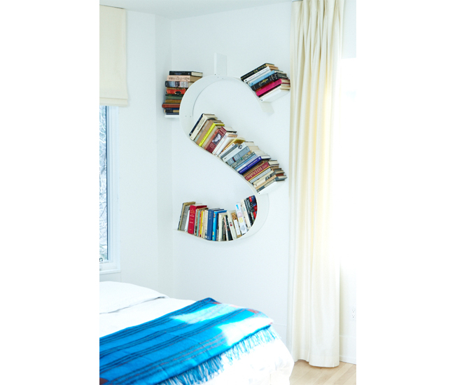 A Bookworm bookshelf by Kartell keeps select favourites tidy in the master bedroom. Photo by Naomi Finlay.