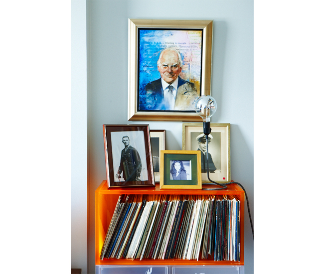 Framed portraits of relatives top a collection of LPs. One System storage unit by Kartell at Quasi Modo; Cord table lamp by Design House Stockholm at Morba. Photo by Naomi Finlay.
