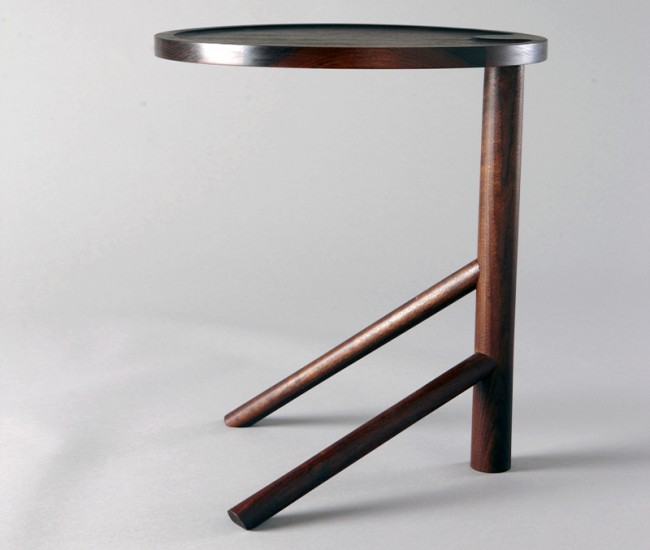 Fieldhouse's Shaker-inspired walnut side table features a digitally cut top and hand-hewn tripod base