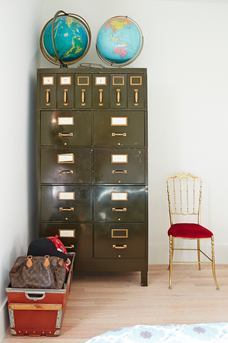 The master bedroom has even more vintage finds. Filing cabinet, Queen West Antiques; globes, Machine Age Modern; chair, St. Lawrence Market.