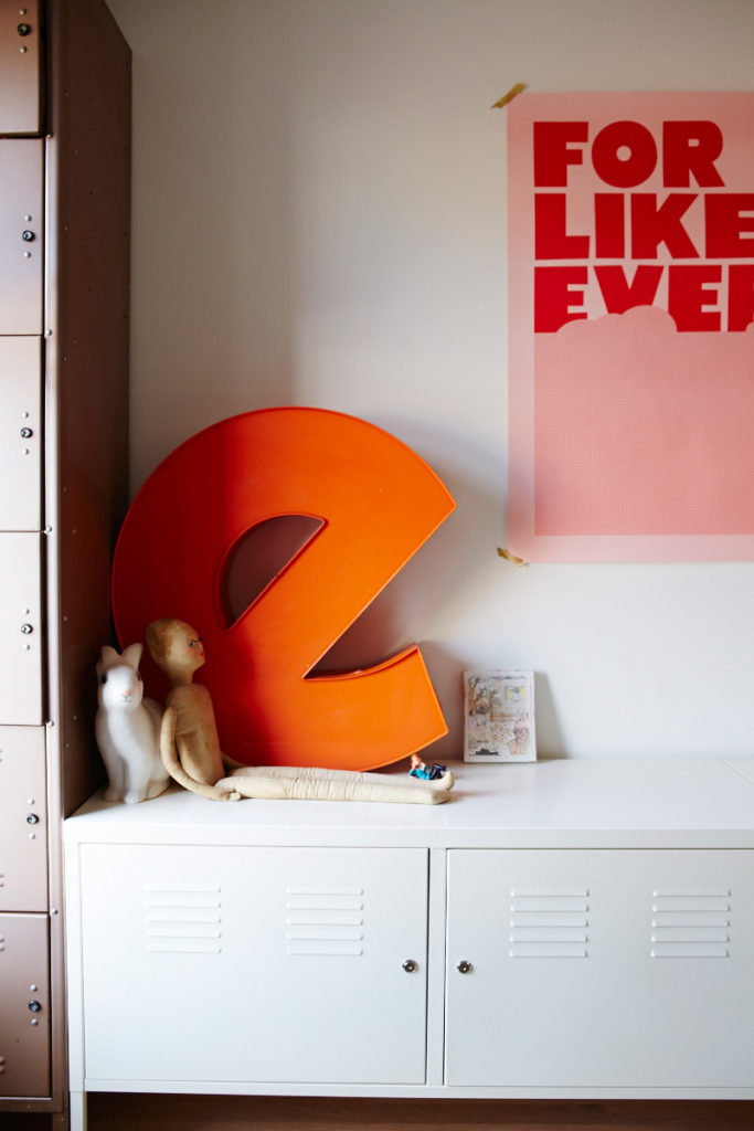 In the nursery, clothes and toys are tucked into lockers from Queen West Antiques. The E sign is a Junction Flea find; print by Tracy Jenkins for Village.