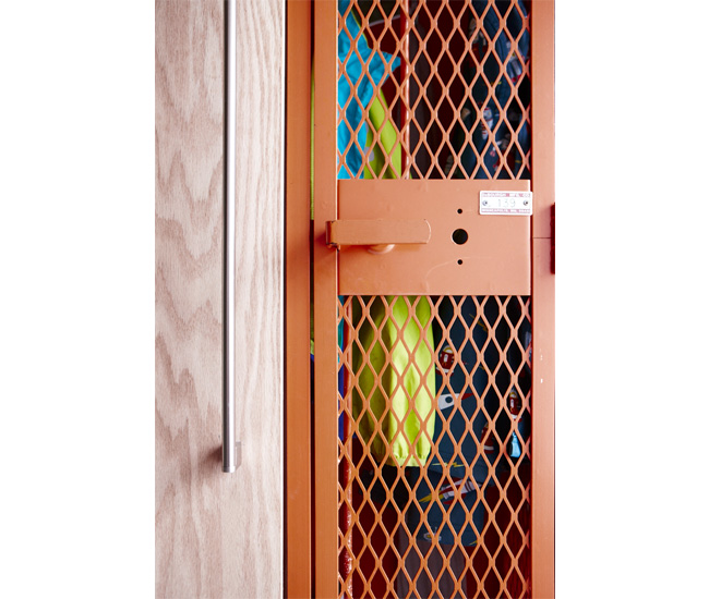 The lockers, sourced from Smash, keep the kids' stuff tidy in the foyer. For the parents, architect Wanda Ely designed a plywood closet with custom-cut shelves. Stainless steel handle by Richelieu.
