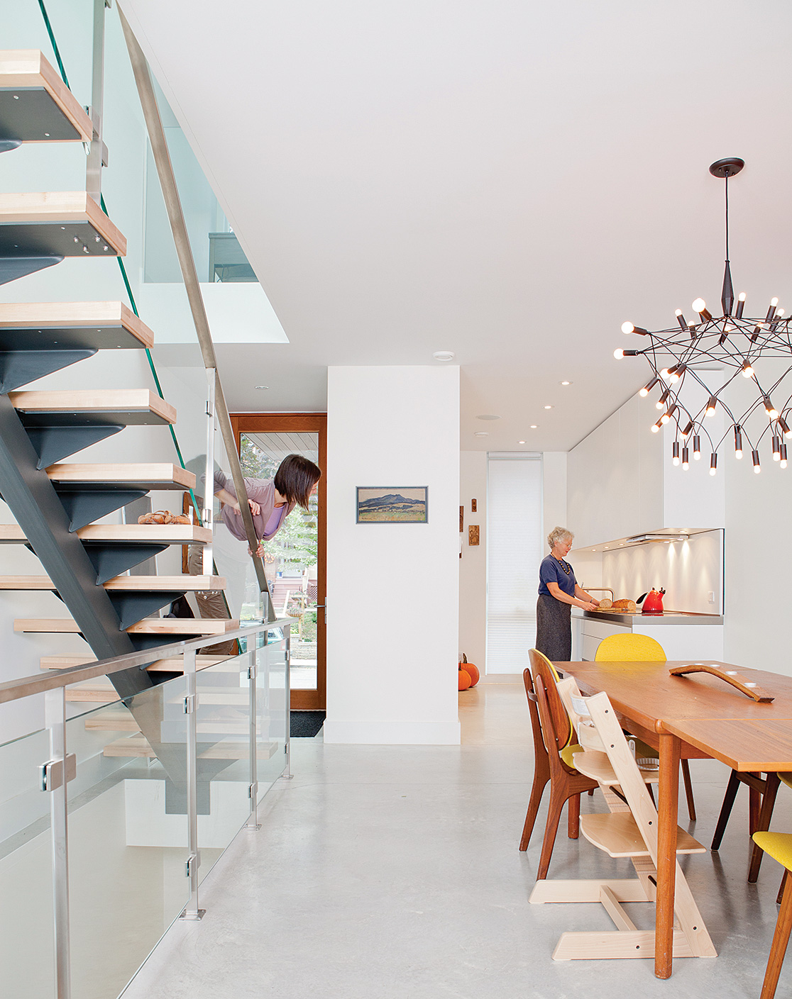 Knezic designed the staircase, with its singular steel support and glass rail, to allow for a clear view of the main floor.