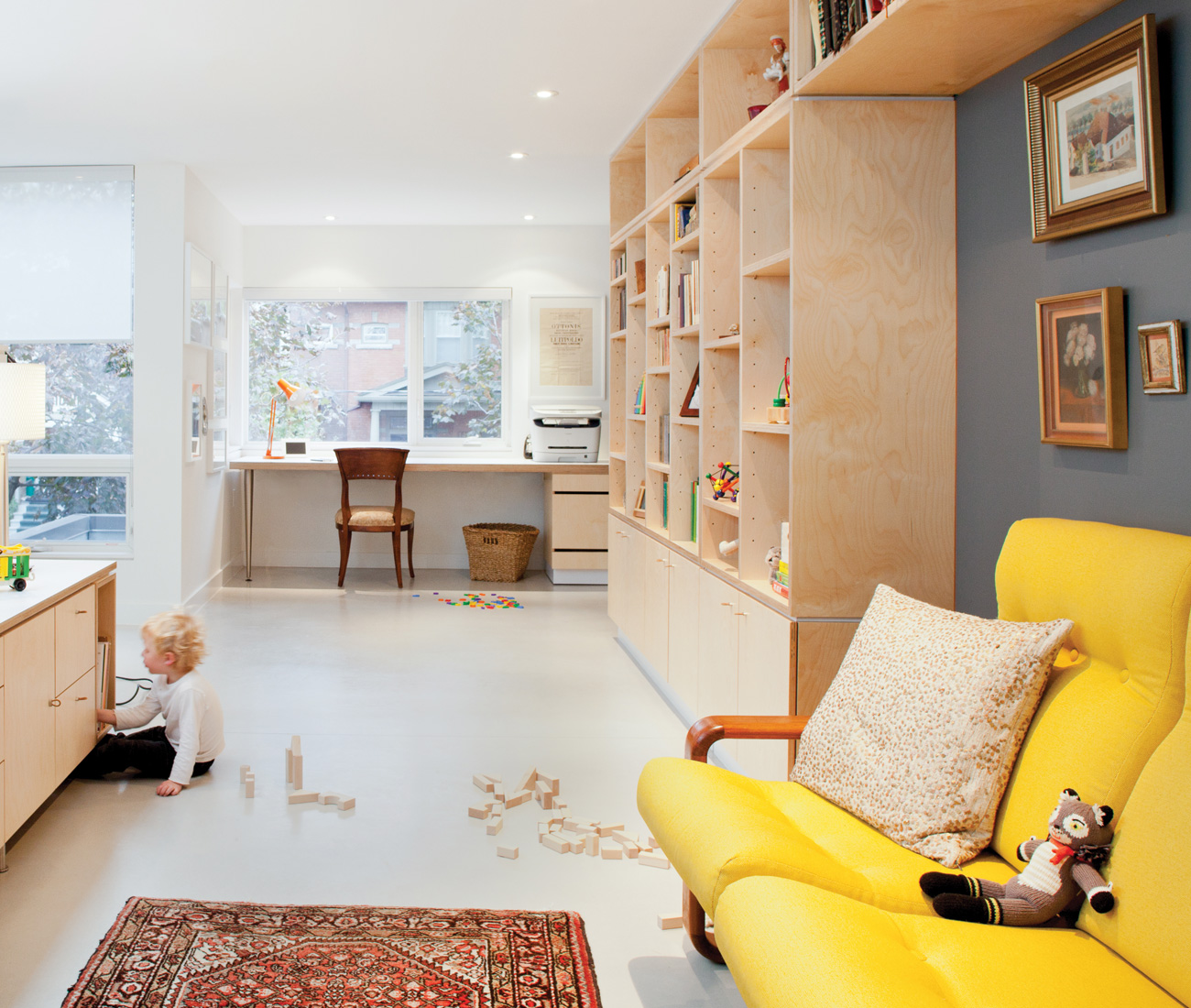 The open-space second floor is bookended by a media room with custom built-ins.