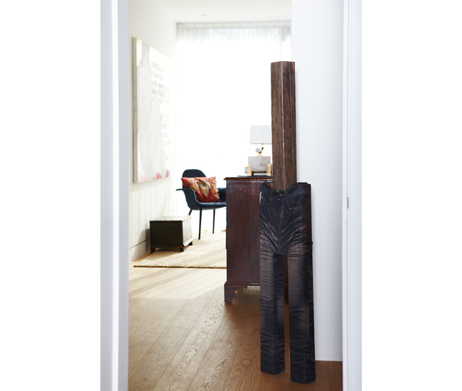Light floods the upstairs office. Wood and tights sculpture by Valerie Blass.