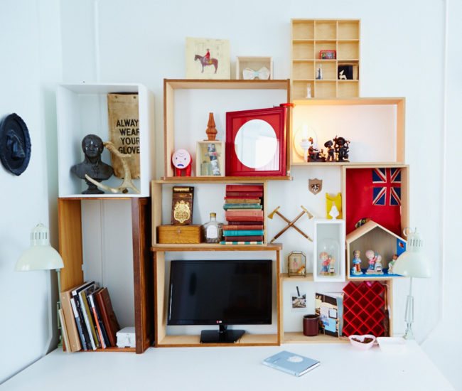 Individual work stations are topped with kitchen counters. Shelves made from bottomless drawers are stacked Droog-like.