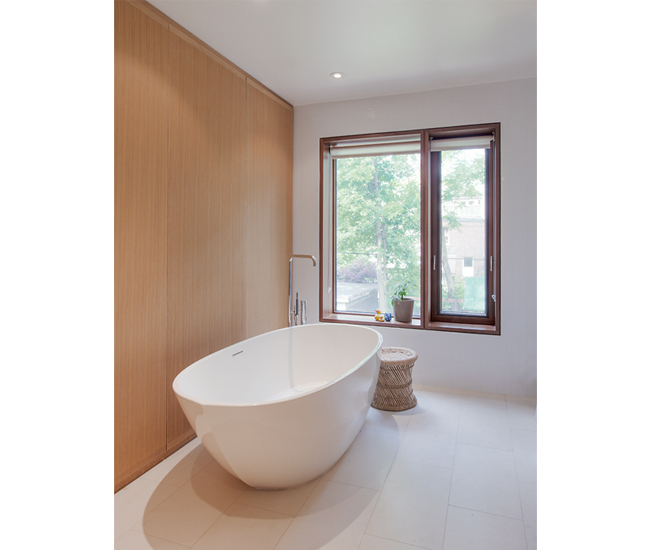 Wetstyle soaker tub from Ginger's; Limestone tiles from Olympia.