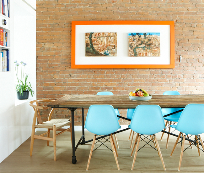 7 Give pride of place to a favourite artwork. Table by Restoration Hardware; Eames-inspired chairs from DesignRepublic. Photo by Naomi Finlay.