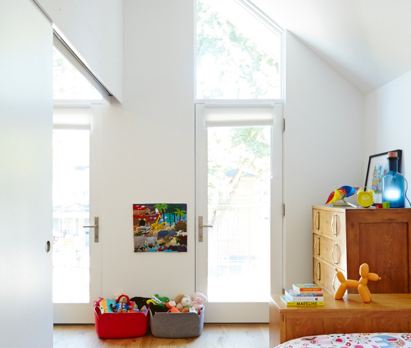 A sliding door dividing the daughter's room from a guest room allows the two spaces to be combined when desired. Pillows, light and felt baskets from DWR, EQ3 and RADform.