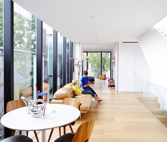 10 Strike a balance between concealing and revealing. In this modern family home, two bedrooms bookend the open-concept second storey. Pivot doors are held open by magnets and swing in to close.