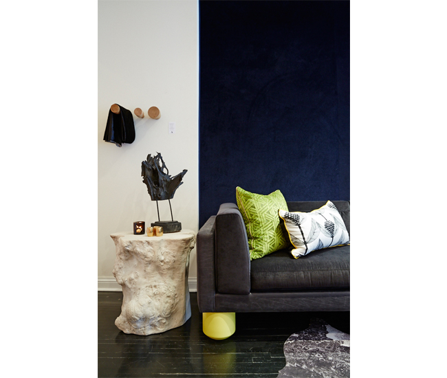 """In true """"lab"""" form, Caplette also displays what he himself is cooking up, including the Nyx sofa: made in Toronto from FSC-certified Canadian hardwood, it features yellow and green legs, as well as an internal hand-knotted support system (from $3,800)."""