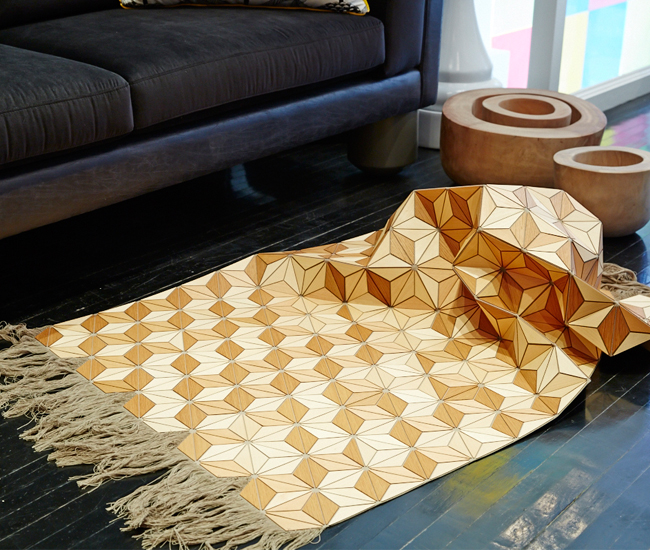 A wooden rug by Boewer hinges together hundreds of wooden triangles into a 152-by-87-centimetre masterpiece ($3,550).