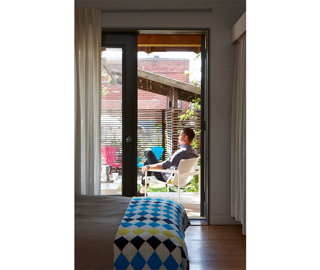 Shed and privacy screens make use of re-purposed interior partitions; blanket from CB2.