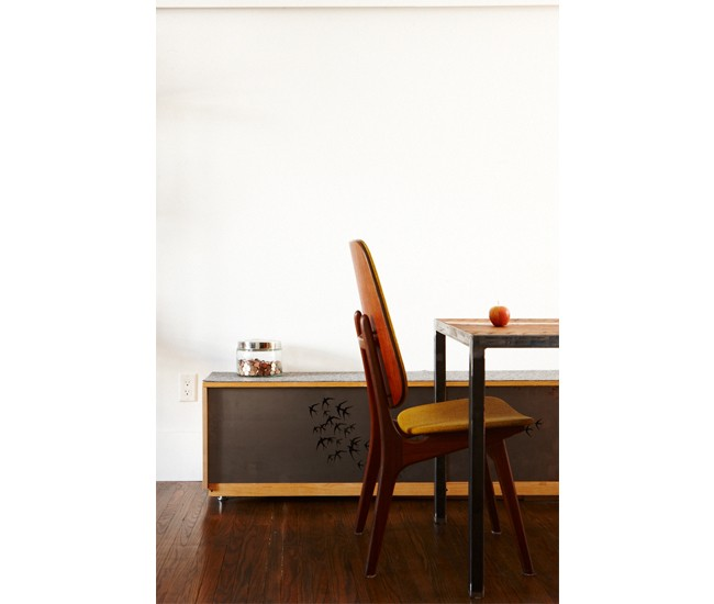 The pine bench is built around an Ikea carcass. Its sliding steel doors are laser-cut with birds. Refinished baseboards top the dining table.