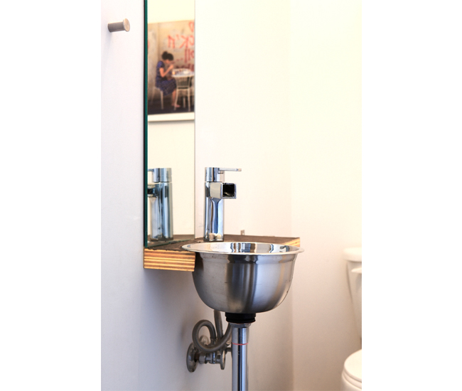 The powder room counter was customized for the salad-bowl-cum sink.