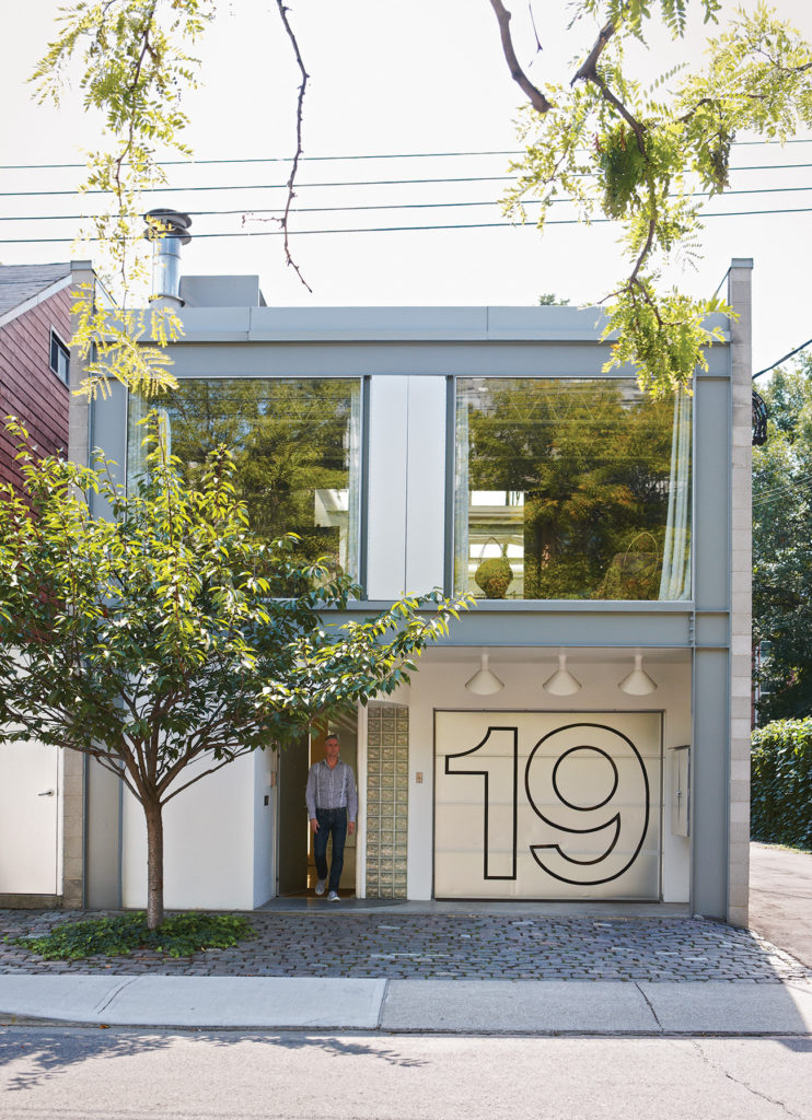 Nestled among the century-old Victorians, it's hard to miss this glass-and-steel house.