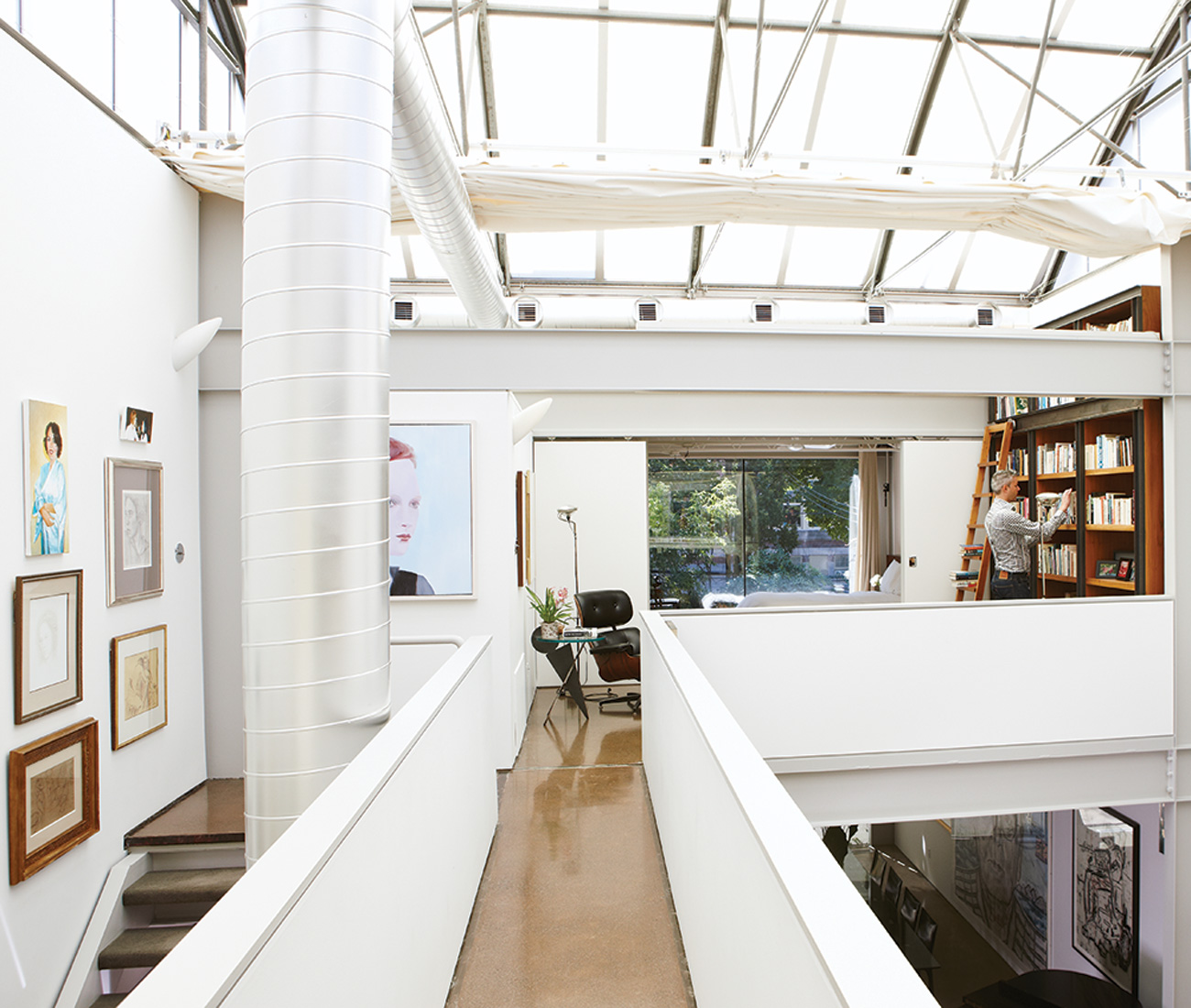 A catwalk upstairs joins both ends of the home. The I-beams were made locally by Algoma and the company's logo can be read in relief throughout the space.