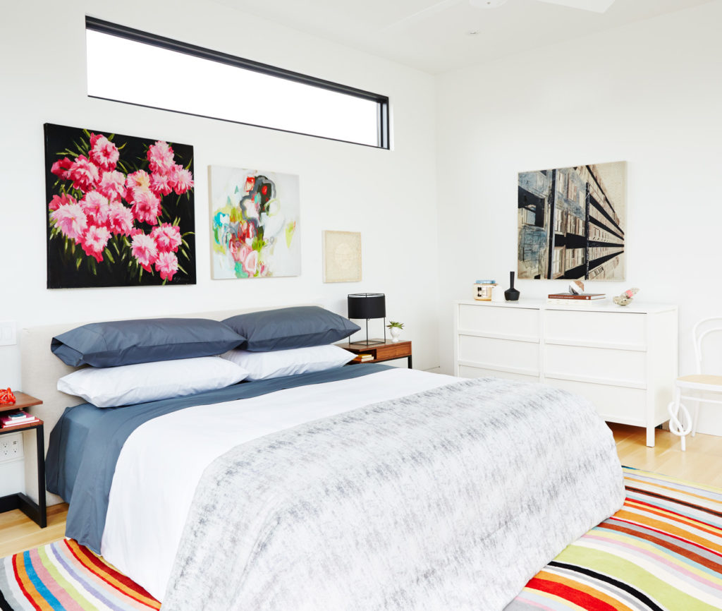 In the light-filled master suite: bedding by AuLit; side chair from Klaus; rug from Avenue Road; bed tables from Hollace Cluny; art from Art Interiors; lamps from Lightform.