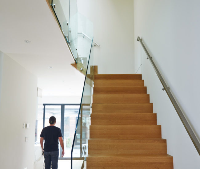 Past the solid quartersawn oak staircase (which opens to four skylights on the third floor) is the kitchen at the back.