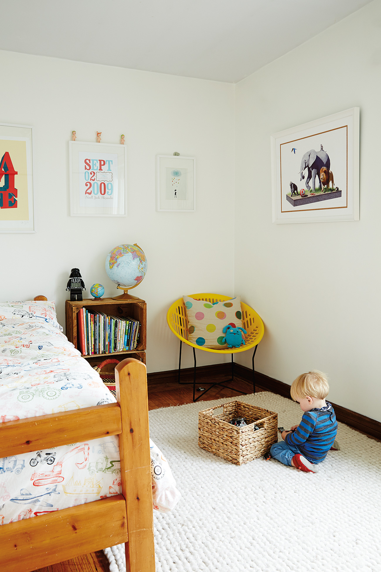 In Noell's room: a prized print of circus animals gone rogue by Josh Keyes. Mini Solair chair from Studio Pazo; duvet by IKEA.