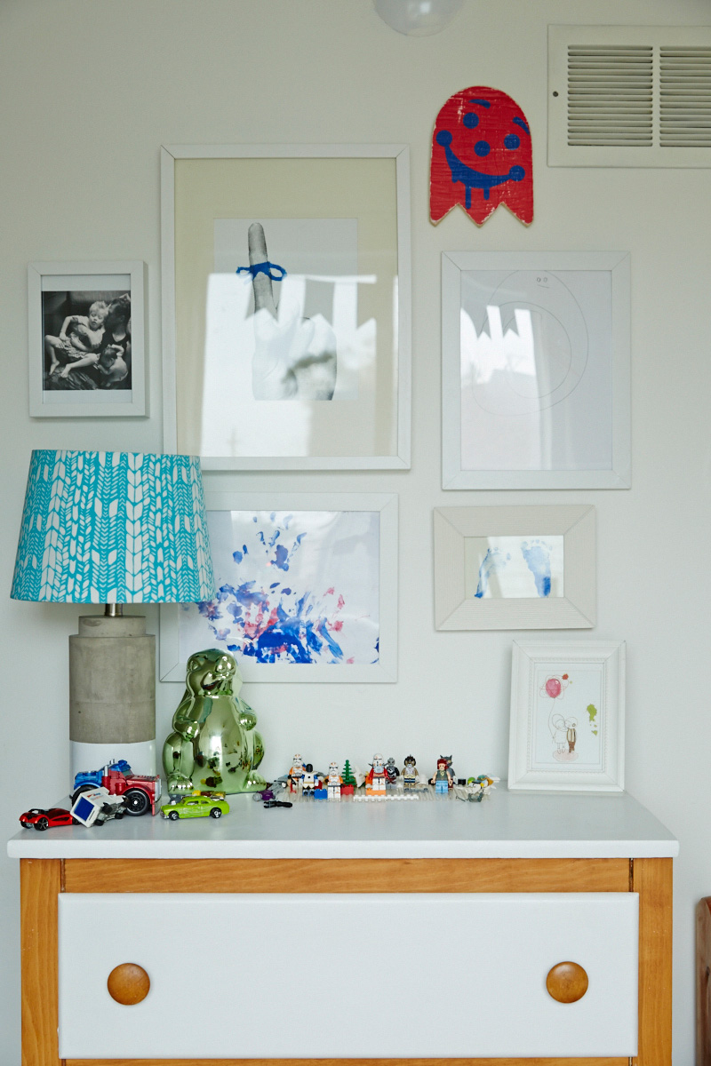 A cluster of Noell's artwork shares space with family photos and a