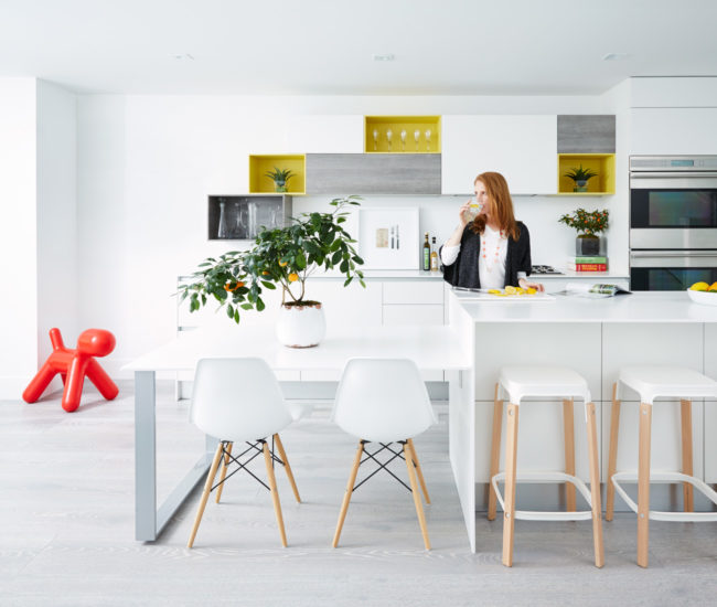 The Scavolini kitchen boasts an island and counters topped with thin slabs of Corian; chairs from Design Within Reach. Photo by Naomi Finlay.