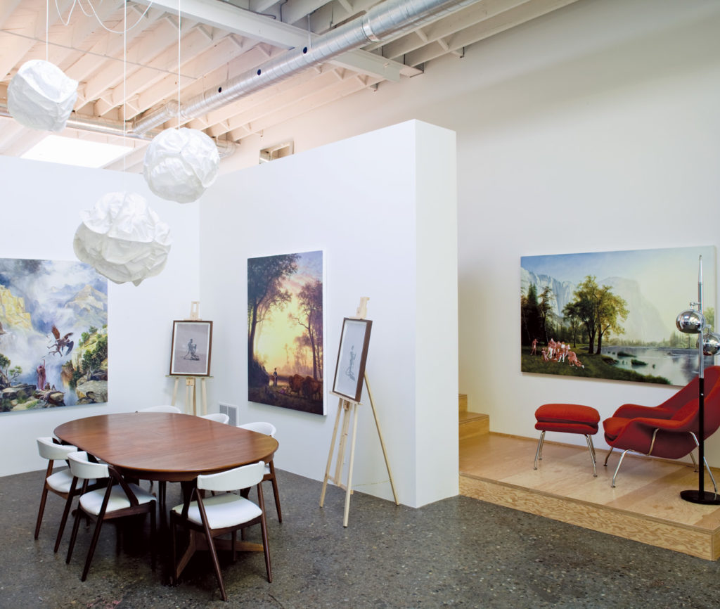 Art at all angles: In the dining area are Gehry Cloud lights (from Plan B), a vintage teak dining set (from Queen West Antique Centre) recovered in bull hide (by New Hope Upholstering) and Monkman's paintings, two of which showed at the 2010 Sydney Biennale.