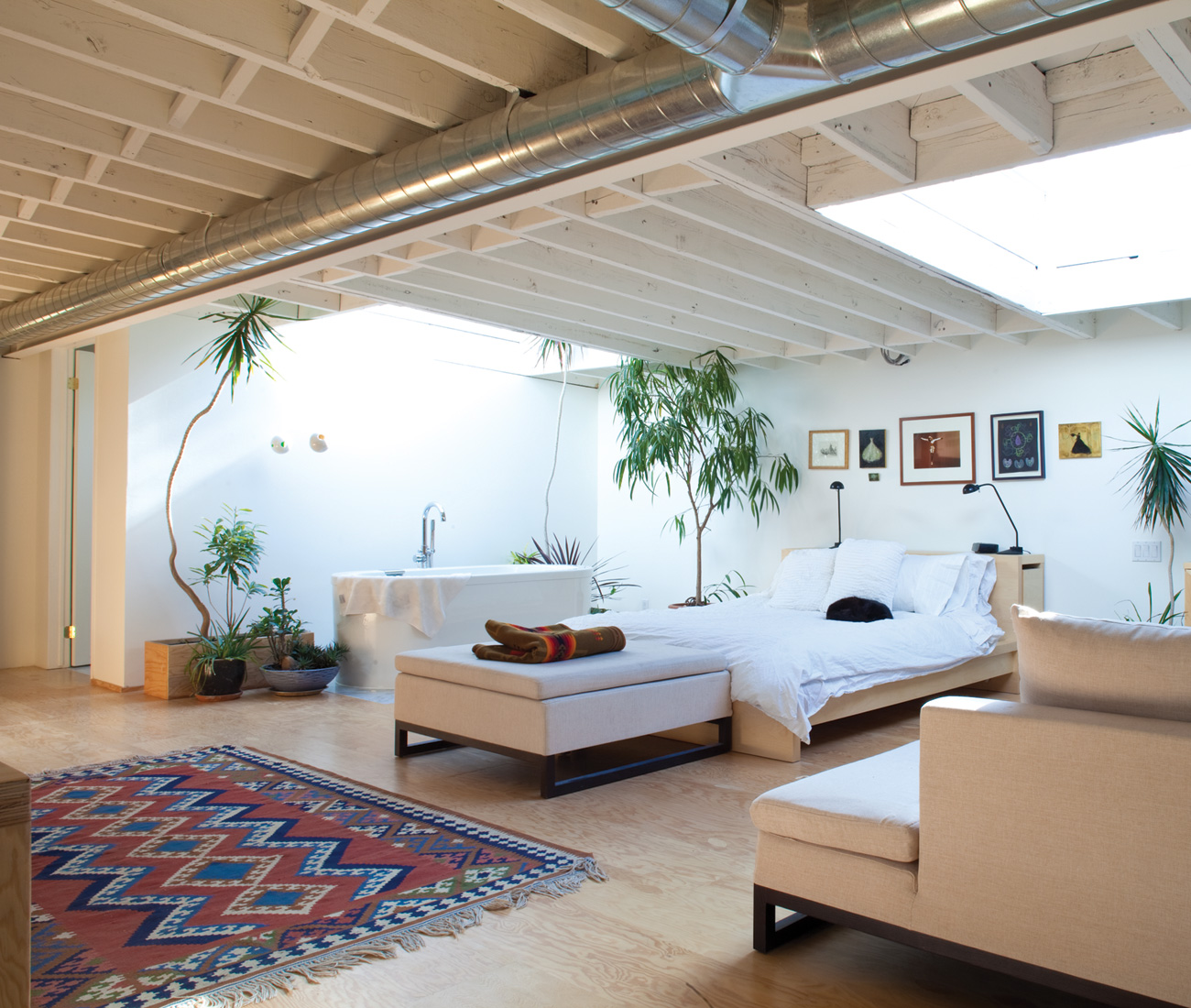 Though the palette is the same, the loft space – with its Douglas fir flooring, Neptune soaker tub and room-warming skylights – is clearly a work-free zone.