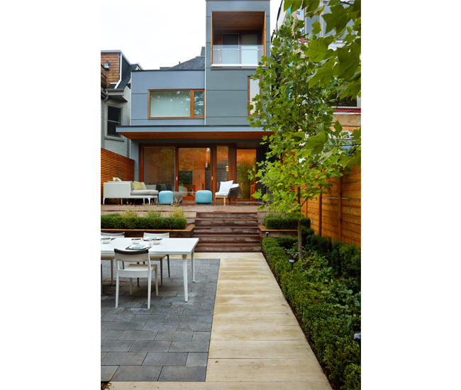 In the backyard, the reinvented Rosedale Georgian combines cedar, polished concrete, steel and river stones.