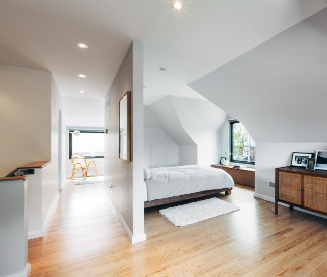 The third floor was gutted in favour of an airy master suite. Its dormers frame leafy, northern views and new mahogany millwork hides duct work. Bed from CB2; cabinet from Queen West Antiques.