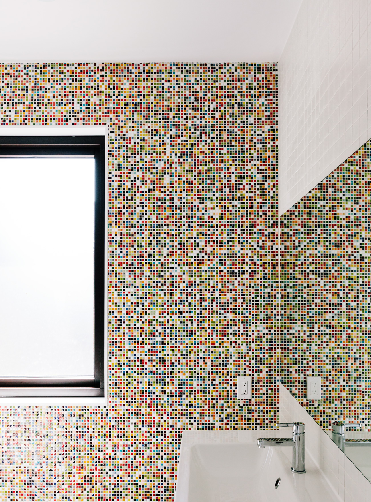 Chiclet-like tiles from Olympia Tile brighten the kids' bathroom on the second floor.