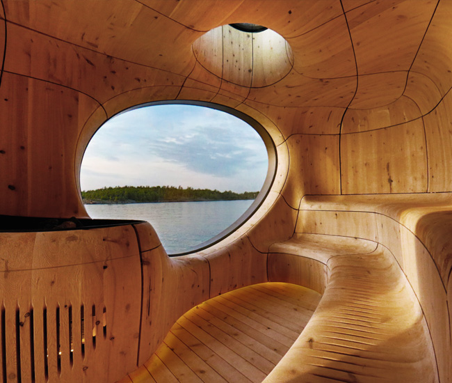 The Grotto Sauna, a private spa on a remote island of the Georgian Bay, is CNC'd from solid wood to create soft curves that embrace sitters.