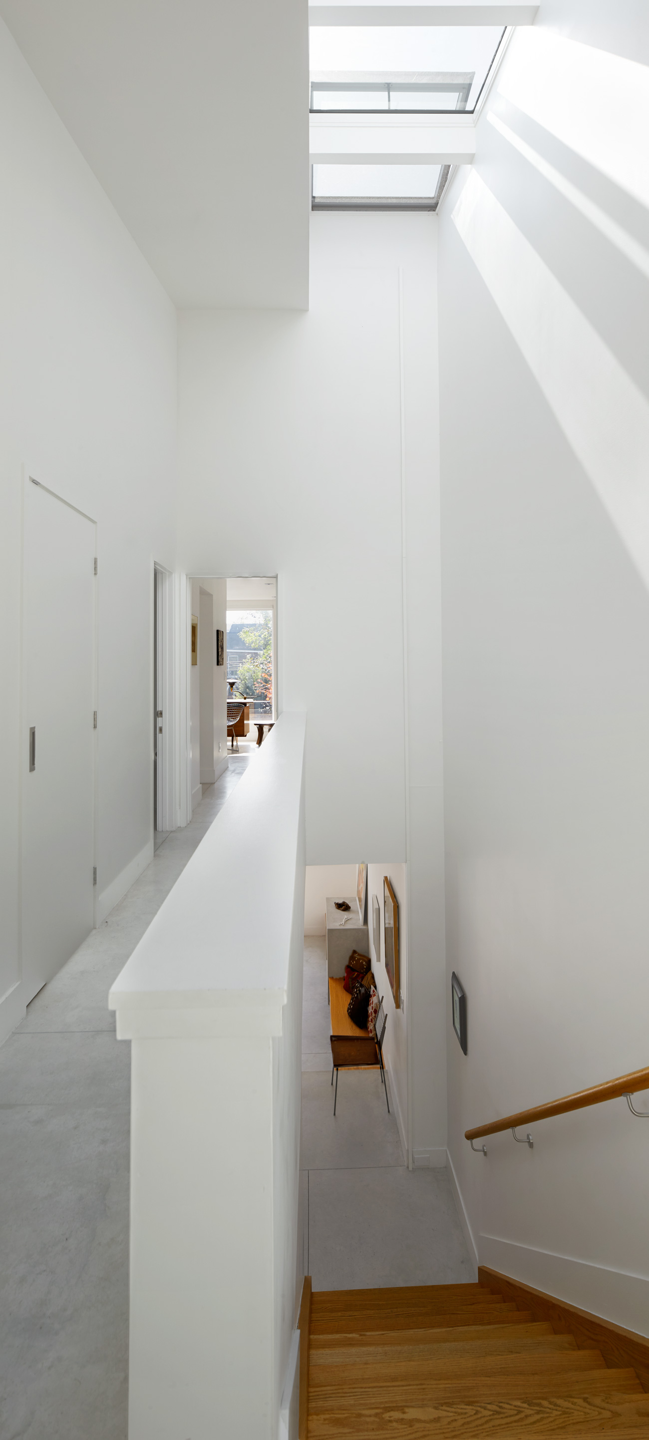 The light well spans two storeys and is capped with a series of remote-controlled windows by Velux.