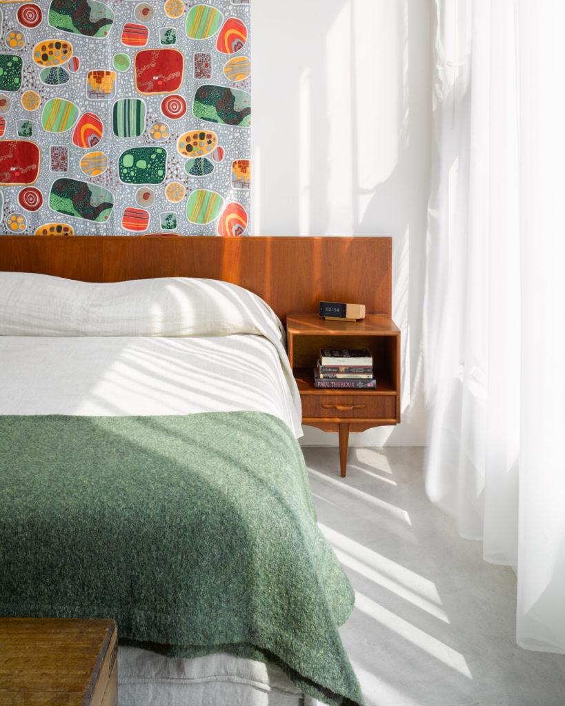Josef Frank's linen Terrazzo hangs behind the vintage teak bed with floating nightstands (aG.U.F.F. find).