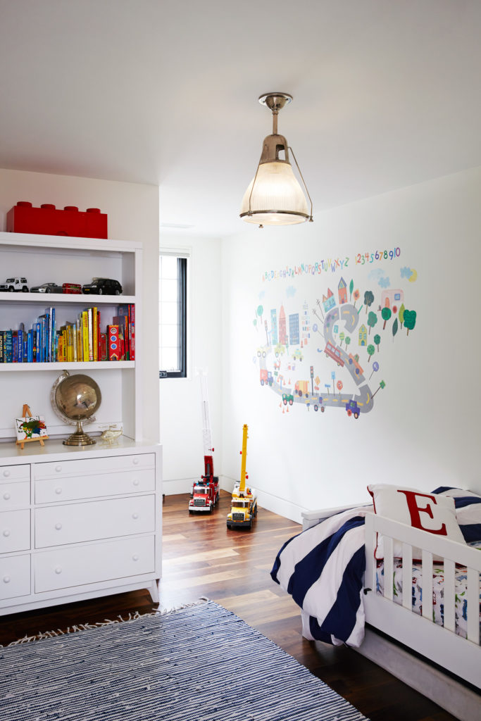 The new north-facing dormer enlarged the kids' bedrooms; an upper-level HVAC system is tucked behind closets.