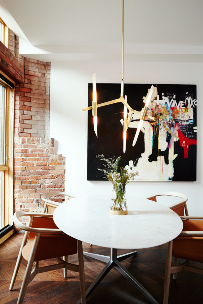 The dining space is graced with a table from Design Within Reach, chairs from Avenue Road and a light from LightForm.
