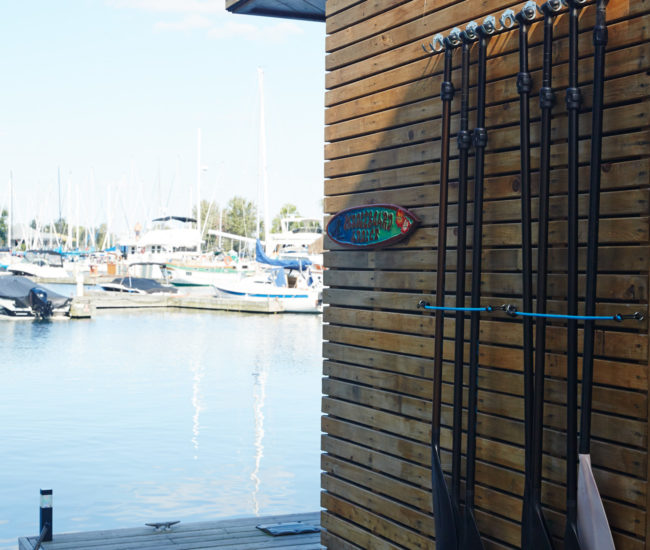 Outside, a cedar-clad wall holds Peic's paddleboard instruction gear.