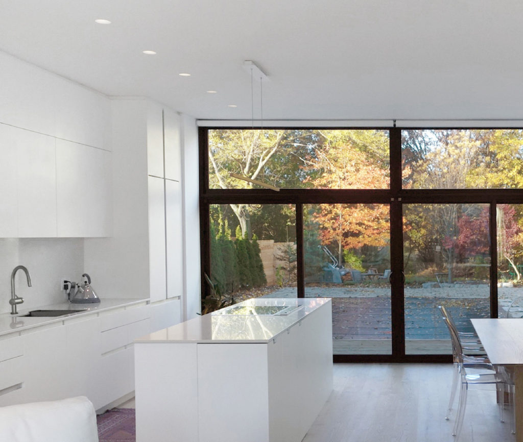 Inline Fiberglass windows filter breezes through the home during the warmer months, and keep it sealed in the winter. Caesarstone-topped custom kitchen by Bendt; PEFC-certified oak flooring from Moncer.
