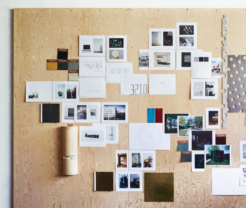 A giant mood board collects avant-garde inspiration, renderings for on-the-go projects, and material samples.
