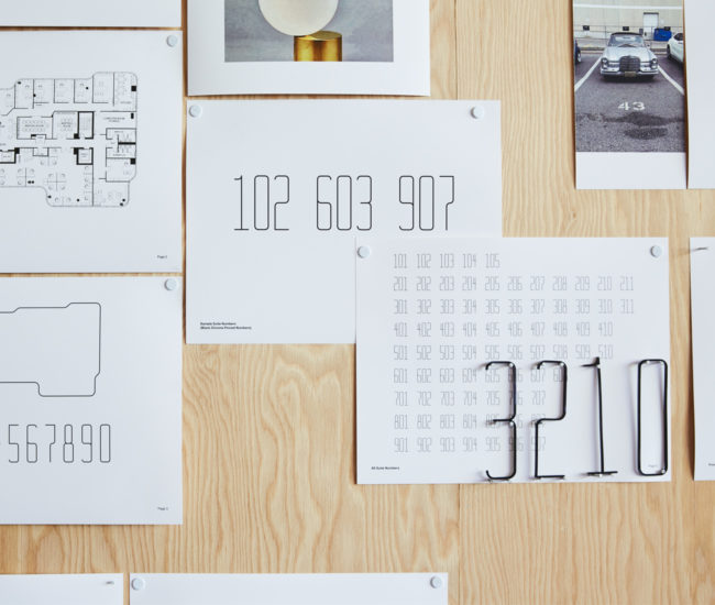 Super-thin steel numbers in a custom font (by Sali Tabacchi) will identify office units in 7 St. Thomas.
