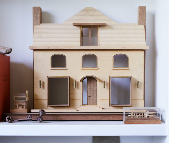 A maquette for a real-estate firm's office they jazzed up with mahogany- and zinc-lined windows.