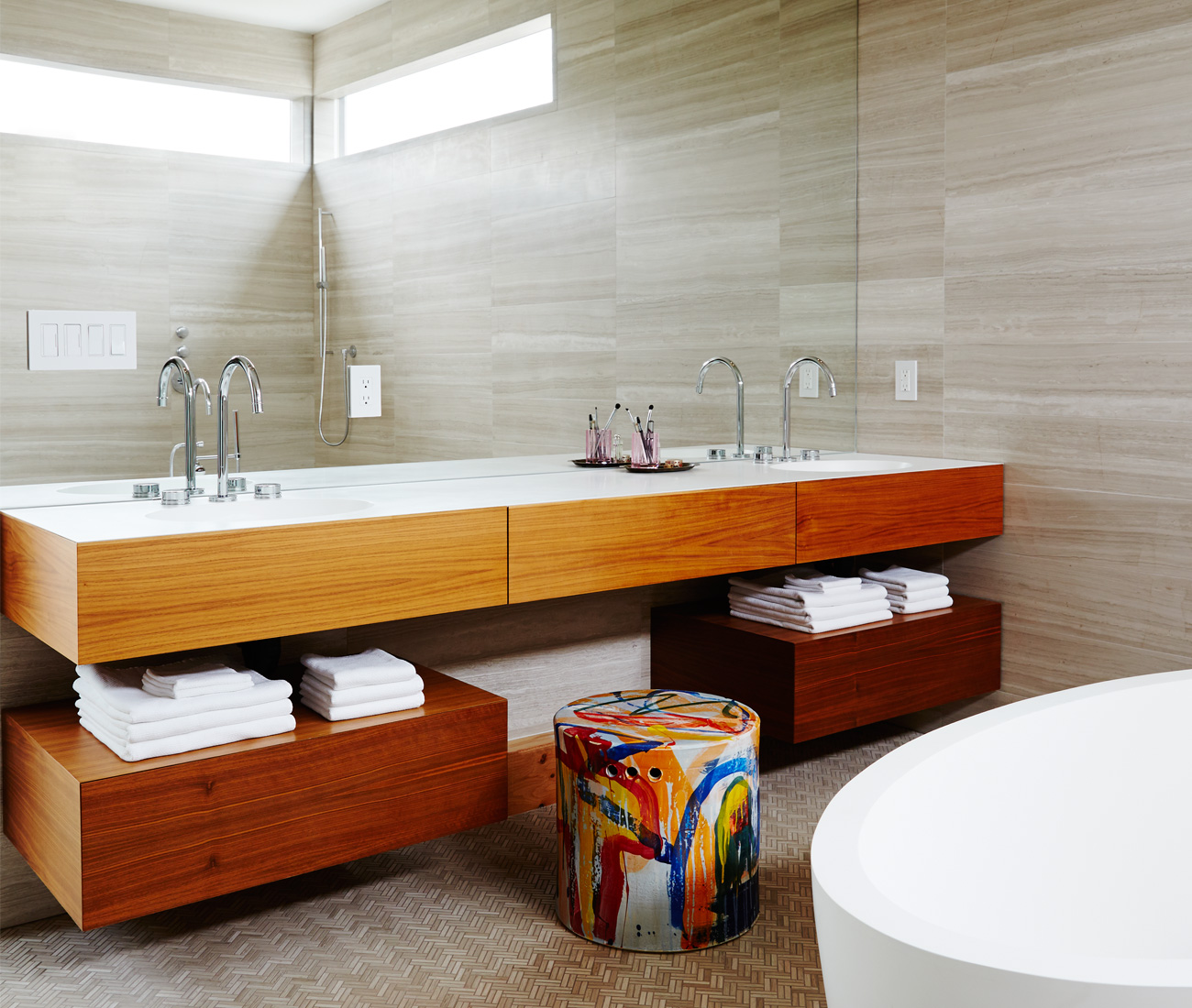 One couple's Parkdale dream home treats the entire master bath as a richly textured wet room (see no. 7). All tile is from Tiles Plus; stool from Hollace Cluny. Mirror and Corian-topped floating vanity are custom. Photo by Naomi Finlay.