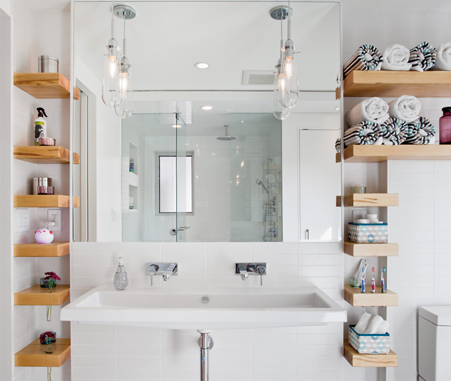 10 Place shelving strategically to provide plenty of space for toiletries. The maple shelves by Space Furniture have routed slots for storing vases, tea lights and toothbrushes. Foating trough sink from ­Everyfaucet.com. Photo by Scott Norsworthy.