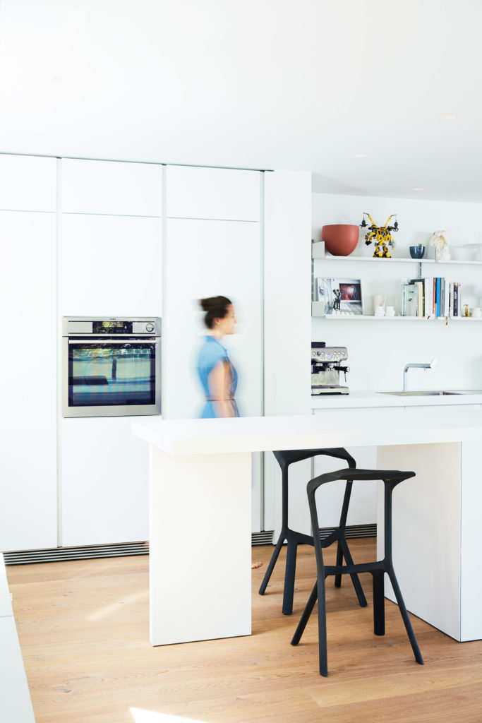 Bar stools by Plank; b1 kitchen system by Bulthaup. Photo by Naomi Finlay.