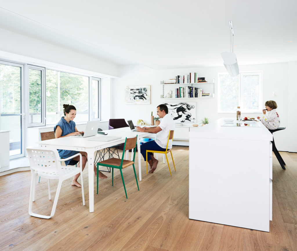 The open plan kitchen/dining space doubles as studio and family room. Flooring by Moncer; b1 kitchen system by Bulthaup; Magis table and red Vitra armchair available at Quasi Modo. Photo by Naomi Finlay.